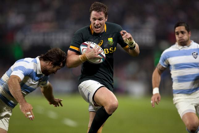 South Africa's Jean de Villiers attempts to avoid the tackle by Argentina's Marcelo Bosch (L) during their Championship rugby union test match in Durban, August 8 2015. REUTERS/Rogan Ward
