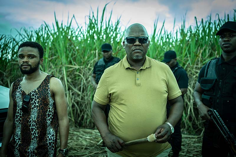 Kenneth Nkosi as Chief Msomi and Phumlani Mdlalose as Fezile